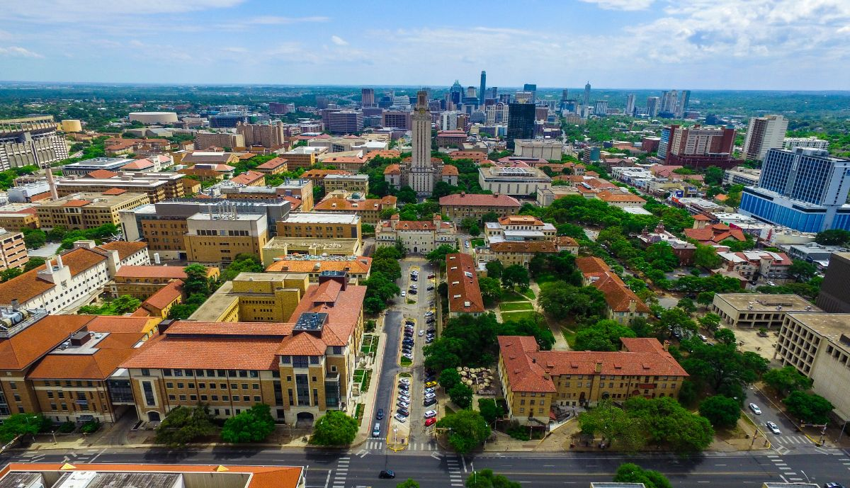 Aerial view of University of Texas at Austin campus with Austin's skyline behind