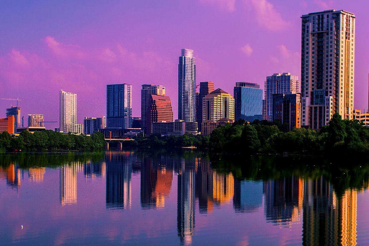 Purple skies behind Austin skyline
