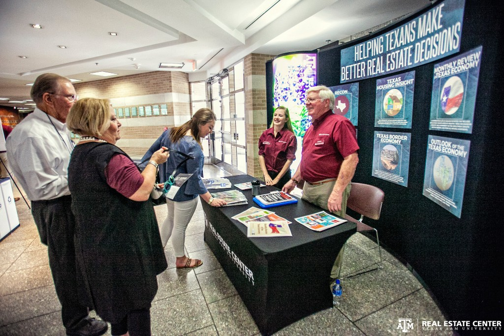 Center Graphic Designer Alden DeMoss and Art Director Bob Beals team greeted Texas A&M University - Mays Business School students, alumni, and staff at the college's 50th anniversary celebration in College Station today.