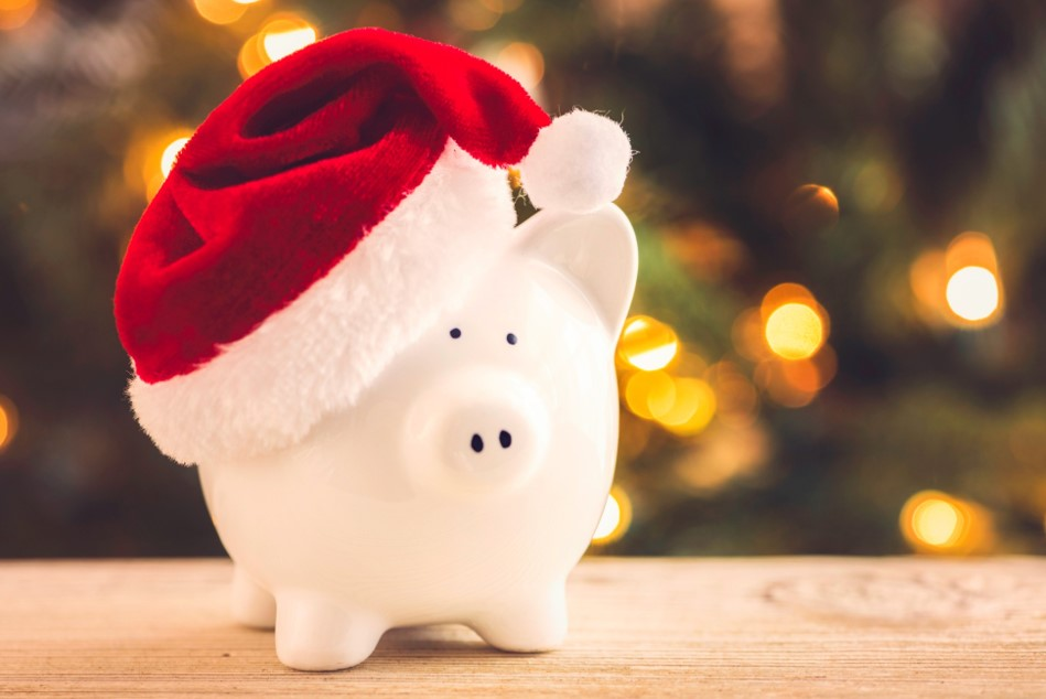 white piggy bank wearing santa hat