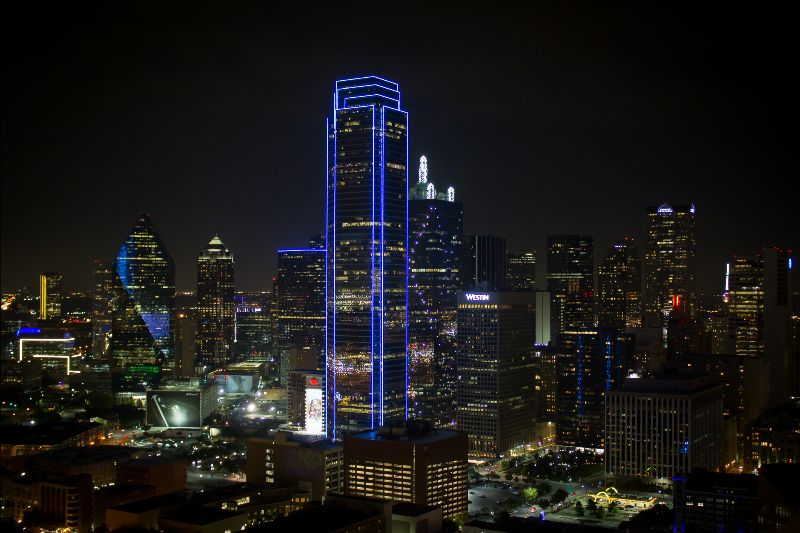 Dallas skyline with Bank of America Plaza lit up in blue