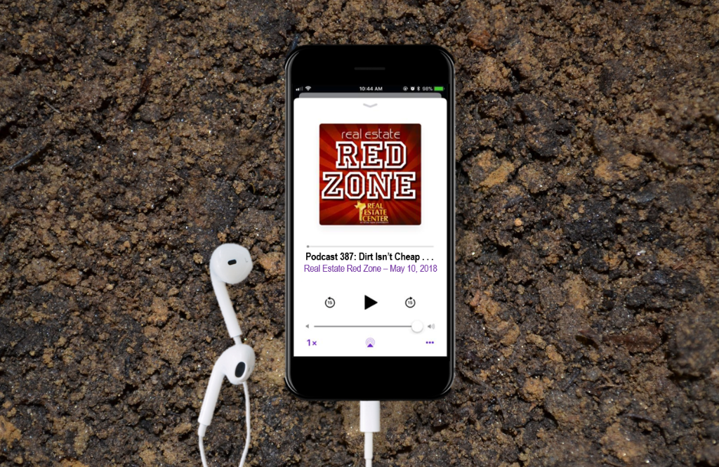 iPhone playing the Red Zone podcast sitting on dirt