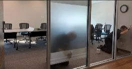Installation of frosting on conference room windows