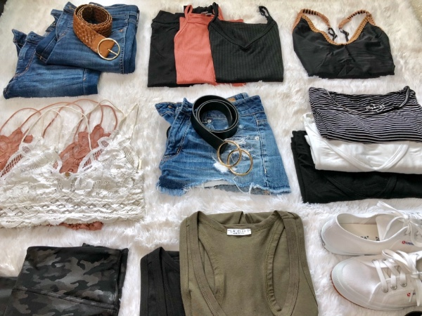 Clothes flatlay with jeans, shoes, tops