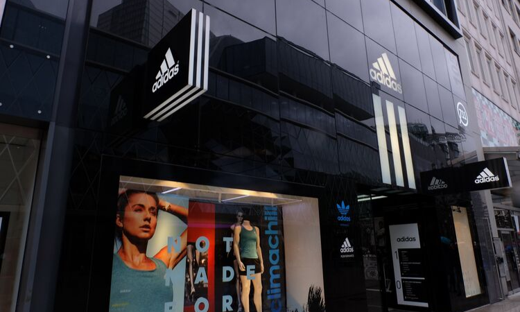 Pictured: the outside window of an Adidas store.