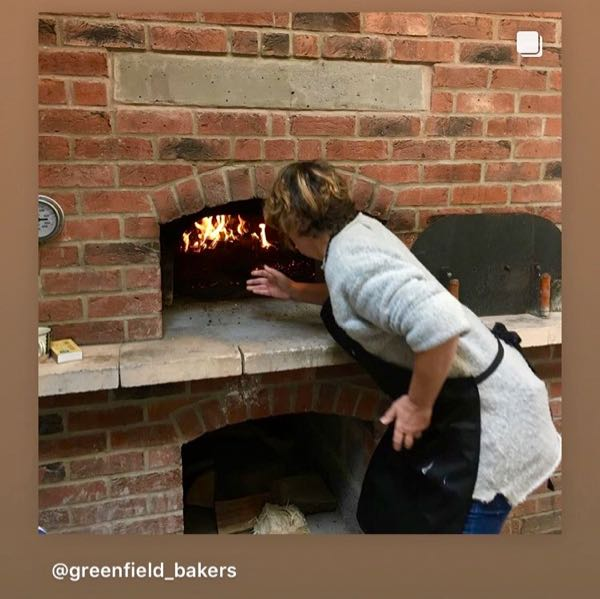 Flinging logs into the woodfired oven