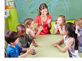 Preschool Teacher and class clapping