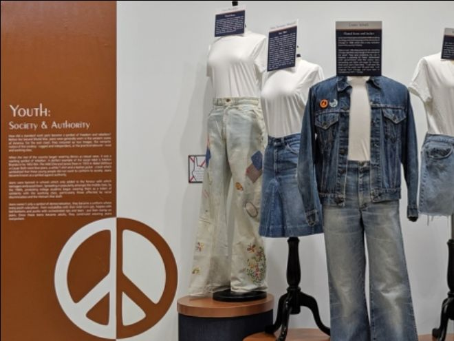 Museum display with 3 mannequins dressed in denim