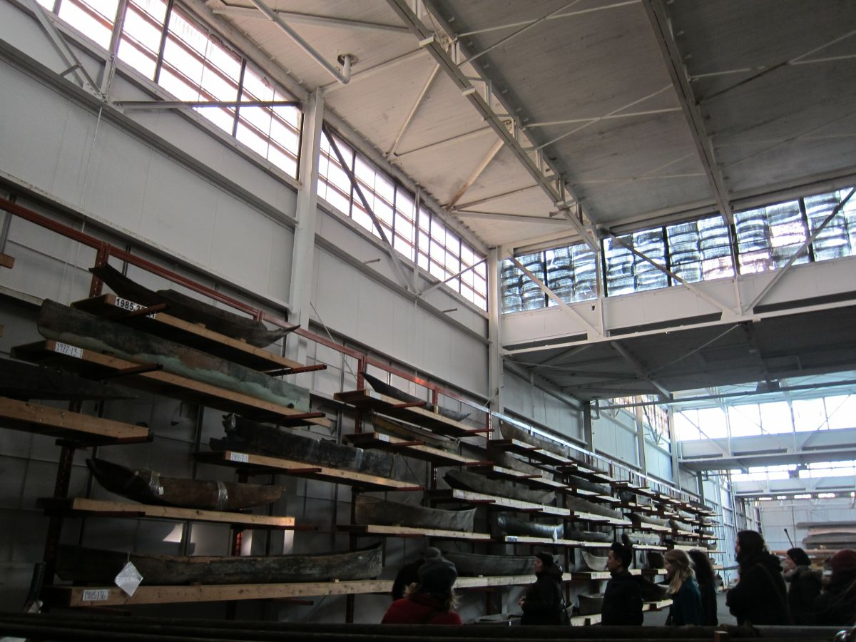 Collections storage warehouse containing antique canoes