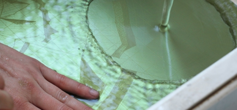 Photopolymer plate being developed with water
