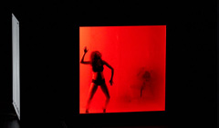 Photo from the show - performer silhouetted on red square