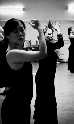 Flamenco students in black and white in a class.