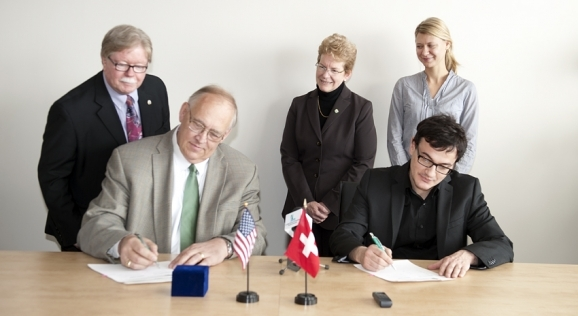 Dr. Hanson signs exchange agreement with University of Lucerne