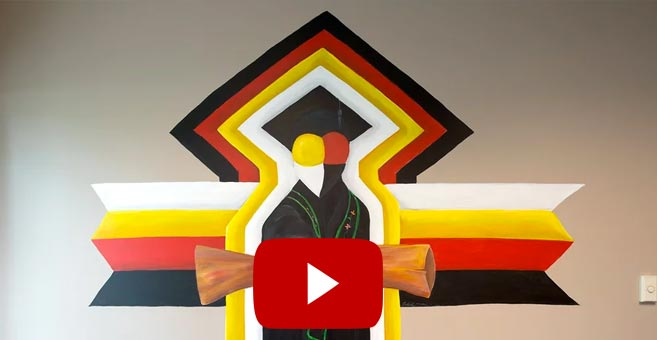 Local artist Wesley May paints mural in BSU's American Indian Resource Center