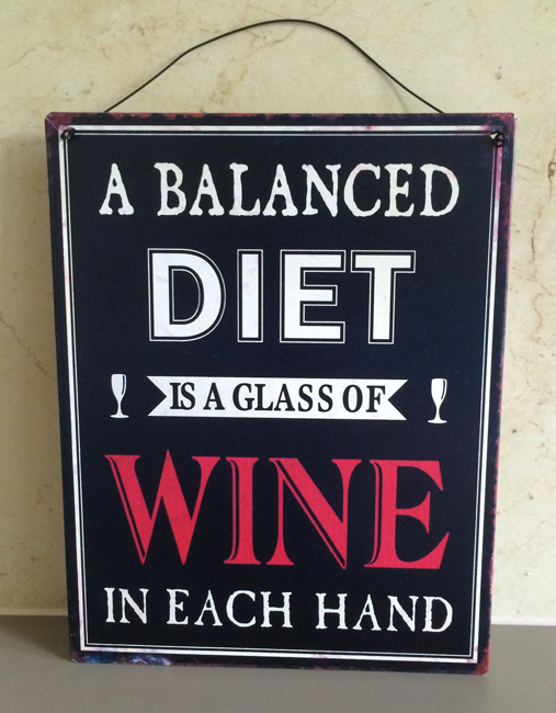 A Well Balanced Diet tin wall plaque