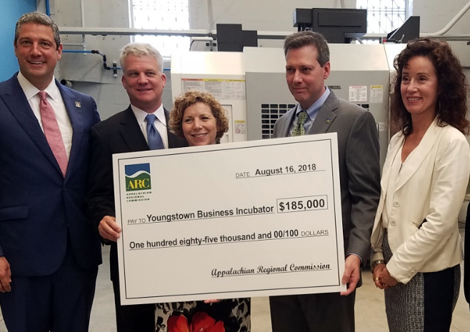 Congressman Tim Ryan (OH-13), Governor's Office of Appalachia's Jason Wilson, YBI's Barb Ewing, ARC Federal Co-Chair Tim Thomas, and Eastgate Regional Council of Government's Kathy Zook  present an ARC grant  to the Youngstown Business Incubator (YBI) in Youngstown, Ohio