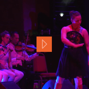 Dancer in front of orchestral musicians