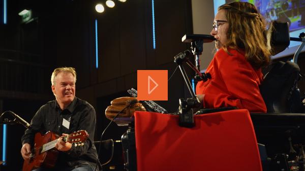 A disabled musician and a guitarist perform a duet