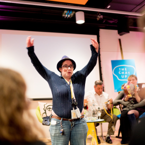 Woman with a hat and her hands in the air