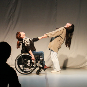 Two dancers, one wheelchair user