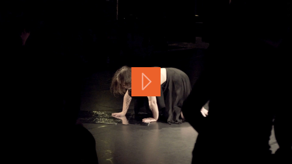 Female disabled dancer staring into a reflective object