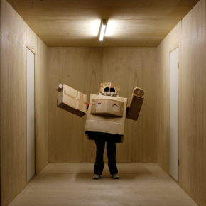 Back to Back theatre: robot costume made of cardboard boxes