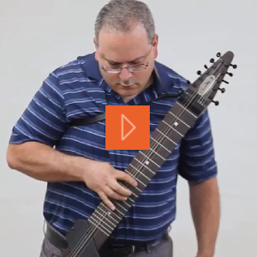 One-handed guitar player on specially adapted instrument
