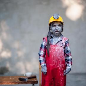 Vesna Mackovic in work overalls and a yellow builder's helmet