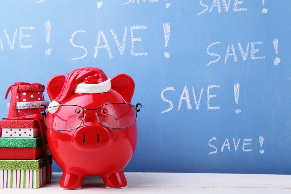 Piggy Bank with savings on black board