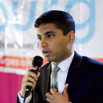 Ritwik Pavan speaks at an event