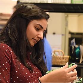 Zareen Farooqui examines a tech device