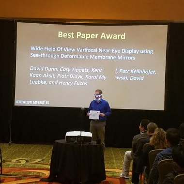 UNC CS doctoral student David Dunn accepts the IEEE VR 2017 Best Paper Award