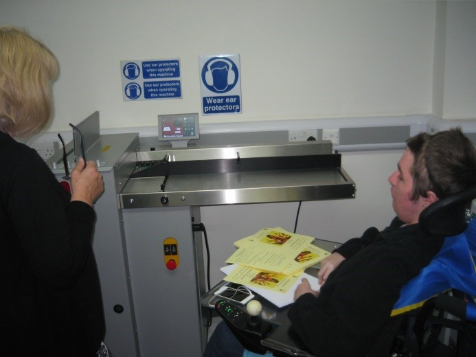 Rob training a new assistant in the use of the DigiFold Pro folding machine