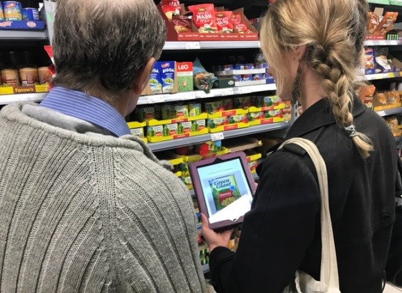 Student becoming familiar with the communication app on an iPad in shop
