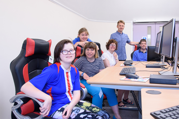 Students and staff using computers at The Grange