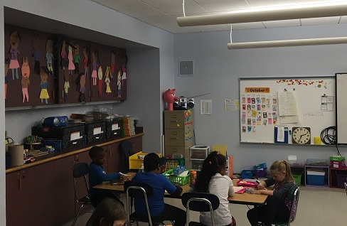 Second grade students do work in the new classroom