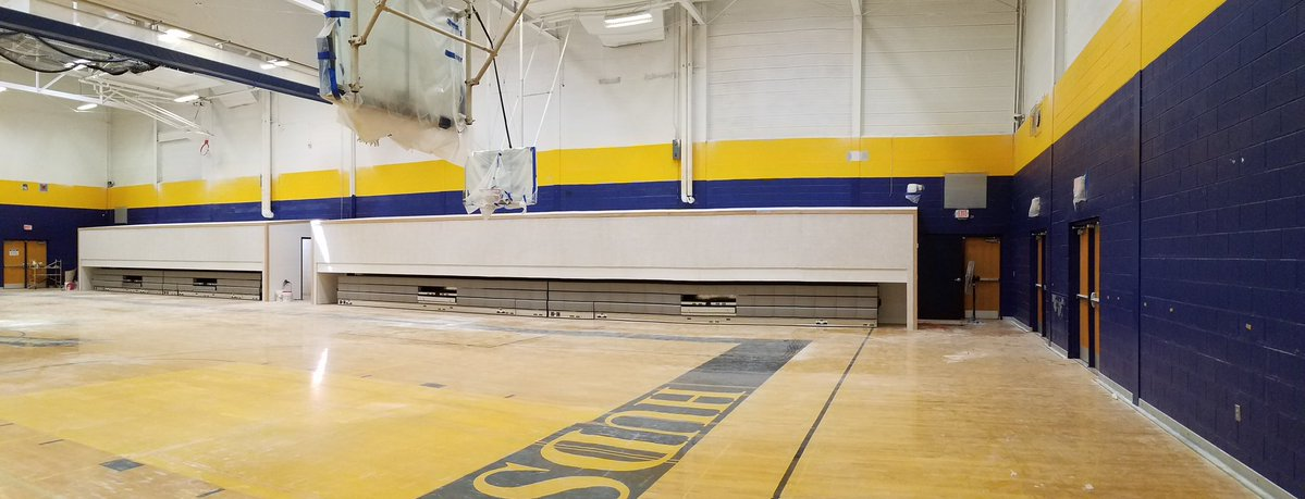 School gymnasium with blue and gold paint