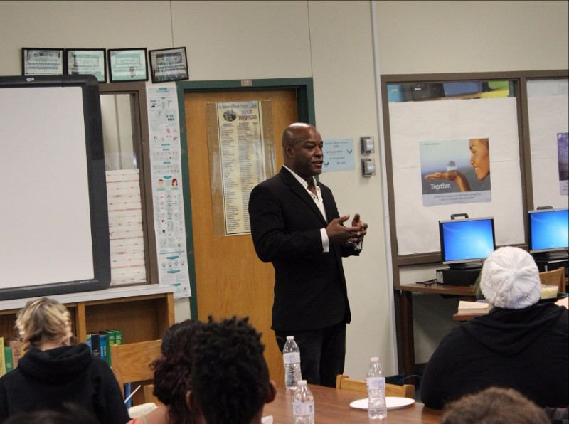 Mr. Thomas speaks to students in the library