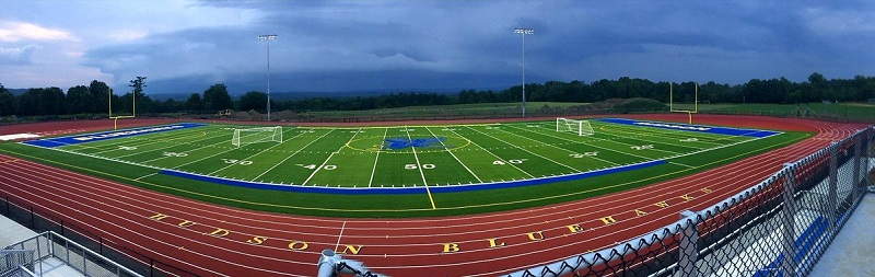 A panoramic view of track and turf field