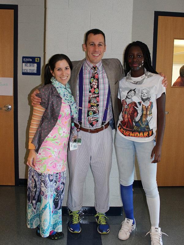 A principal, teacher and student wear wacky outfits for Spirit Week