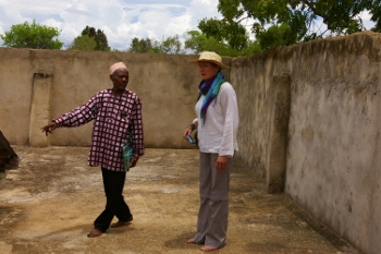 Omar Abdallah Juma (left), Secretary of Wasini's Beach Management Unit, tours a water storage cistern with Seacology's Program Manager Karen Peterson