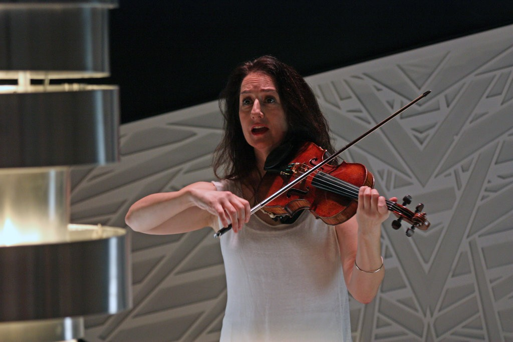 "The violinist Monica Germino in ""Muted,"" presented by the Philharmonic at National Sawdust in Brooklyn.CreditHiroyuki Ito for The New York Times"