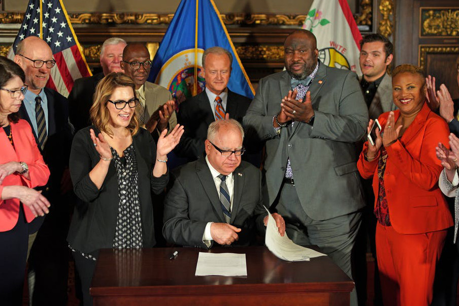 Governor Tim Walz signing the covenant bill