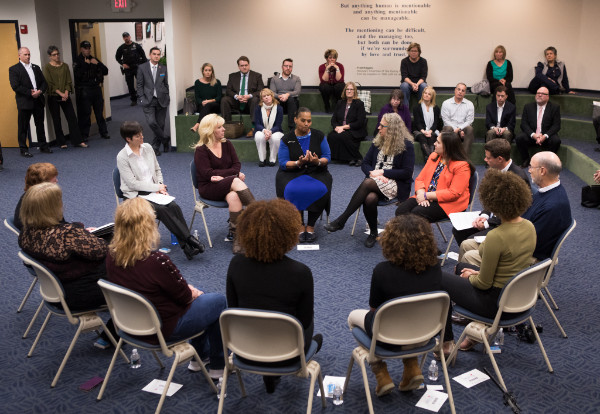 DHS Acting Secretary Teresa Miller, Gov. Tom Wolf, and other members of the Wolf administration sit in a circle with grandparents who have been affected by opioids.