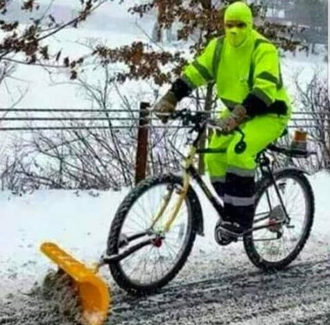 Snow plow on front of bicycle