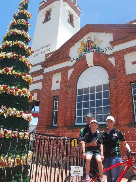 The team outside Stanthorpe Post Office next to the Christmas Tree