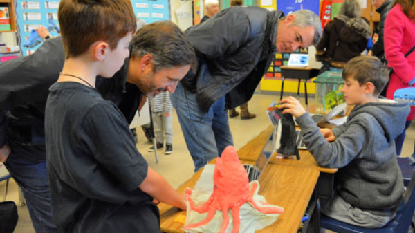 Parents and guests visiting the 5th Grade Sea Creature expo
