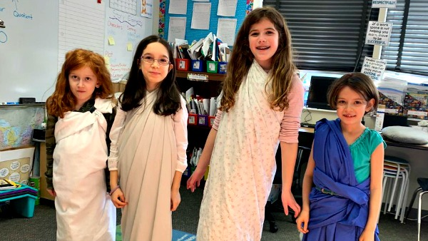 "Four students dressed in Roman ""togas"""