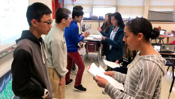 Students interview eachother about food preferences in Chinese III
