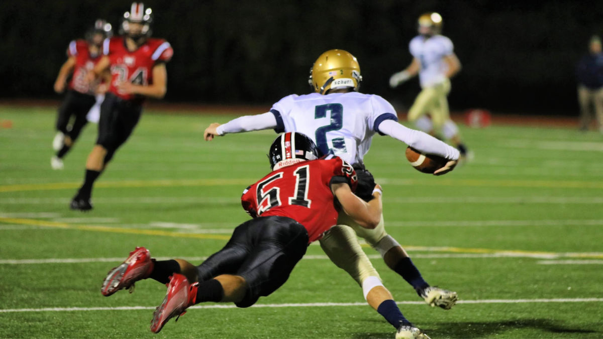Mustang tackles opponent during Friday night's game